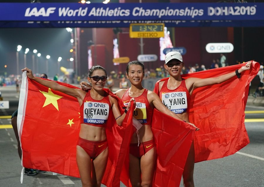 A file photo taken on September 30, 2019 shows gold medalist Liu Hong (centre), silver medalist Qieyang Shijie (left) and bronze medalist Yang Liujing after the women's 20km race walk during the 2019 IAAF World Athletics Championships in Doha. © Xinhua/Xu